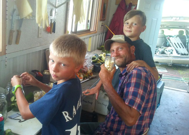 Gus, Eric and Dene working on preserving seconds garlic at We Grow LLC